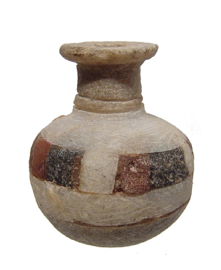 A beautiful Greek inlaid alabaster cosmetic vessel