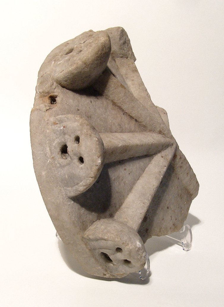 A Roman marble cinerary lid with theater mask motif