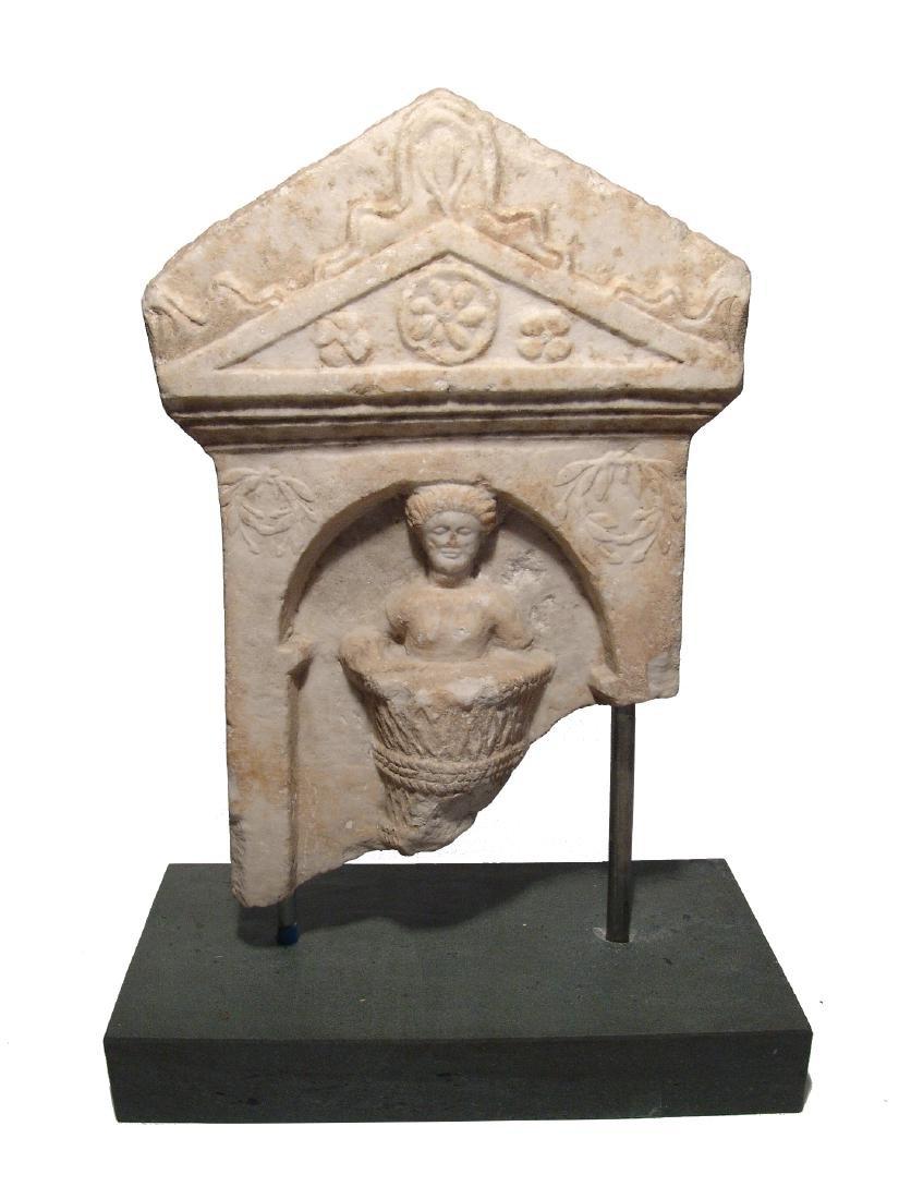 A fantastic Roman marble funerary stela