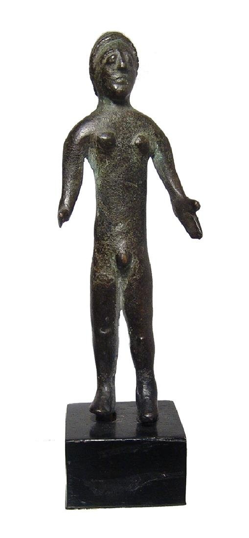An Etruscan bronze figure of a nude male