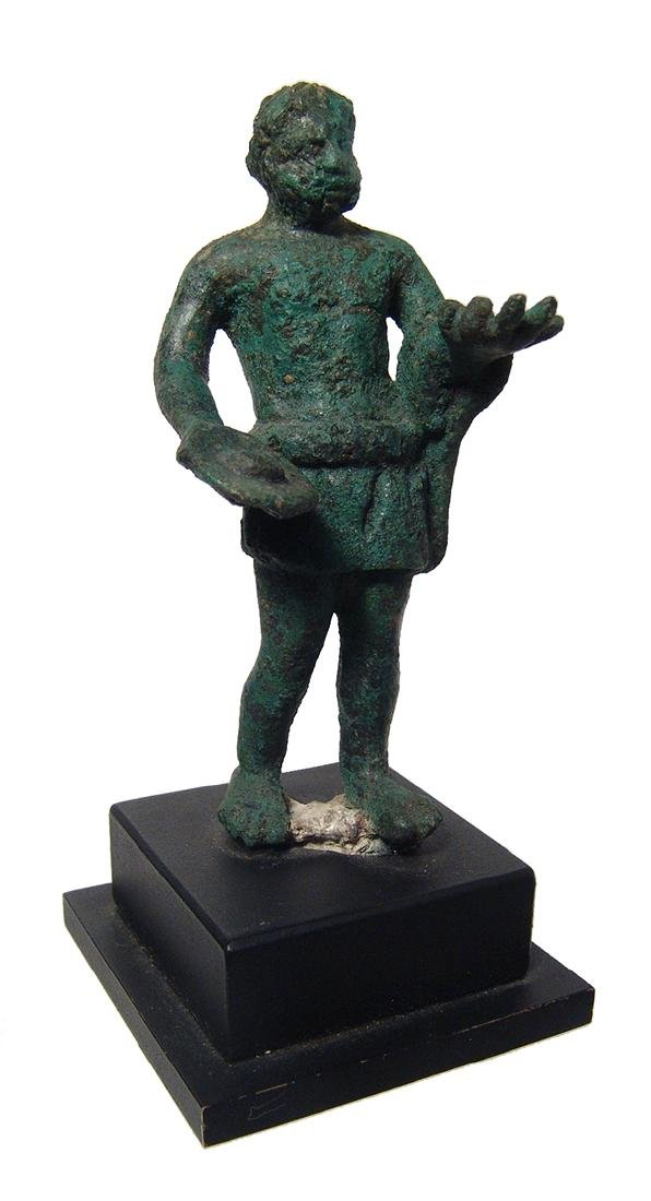 An Etruscan bronze figure of an attendant