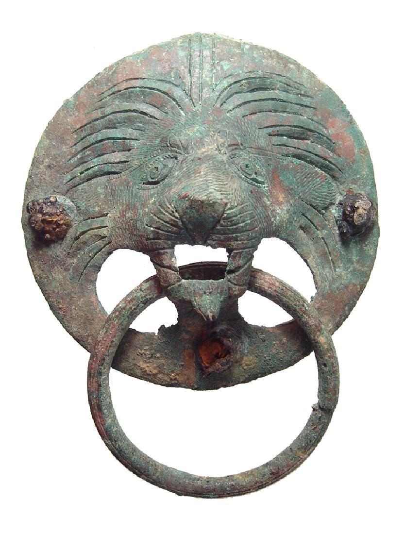 A lovely Roman bronze lion mask door knocker