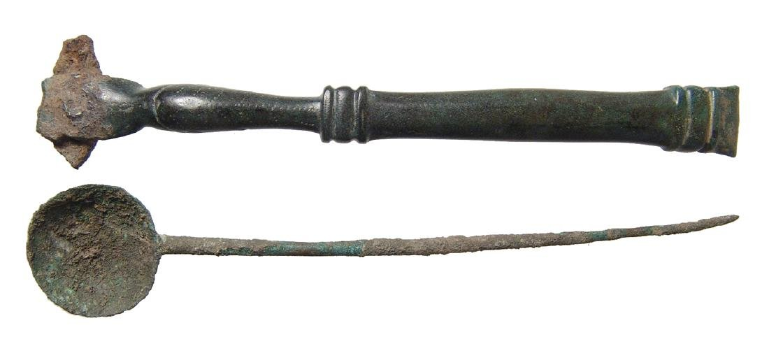 A pair of Roman bronze implements