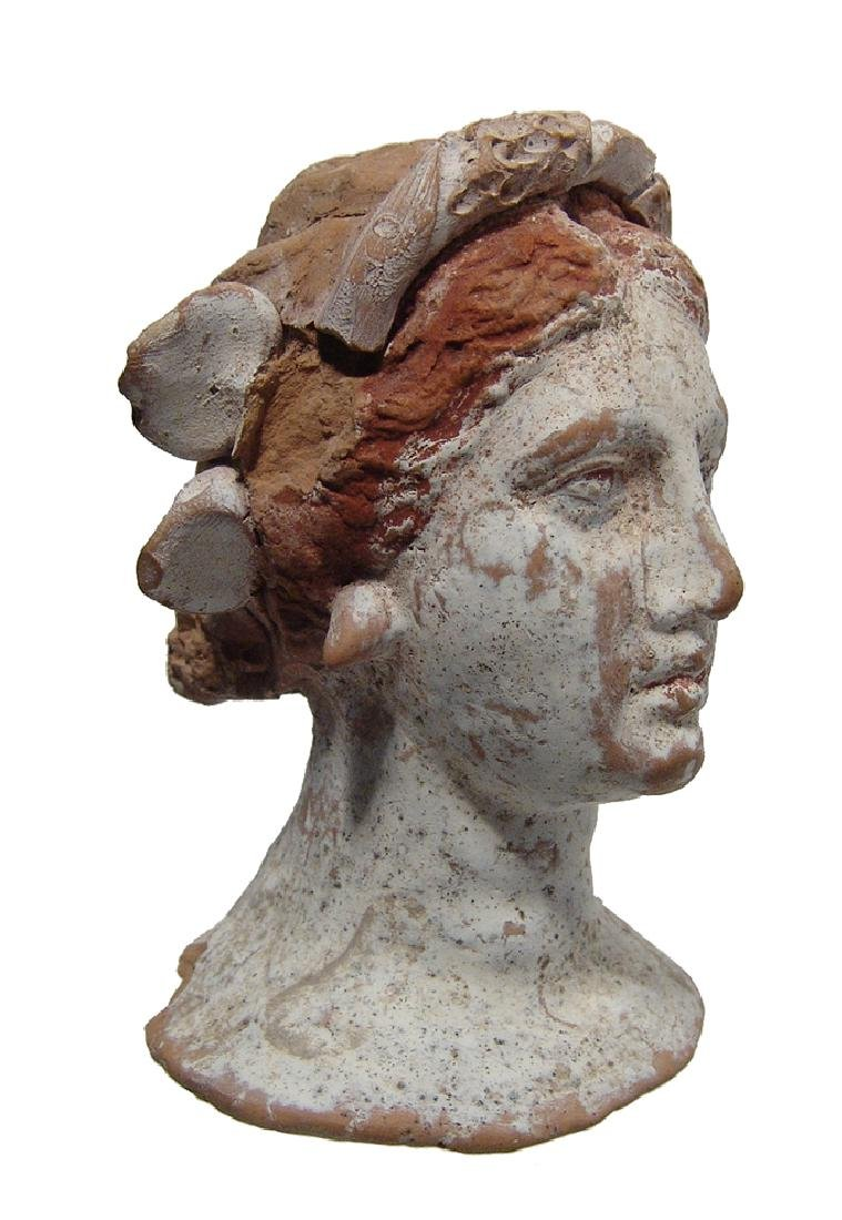 A gorgeous Canosan terracotta head of a woman