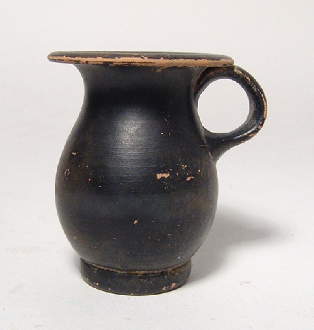 A Greek black-glazed olpe, Magnia Graecia