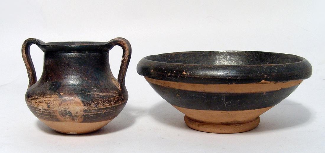 A pair of Greek black glazed vessels