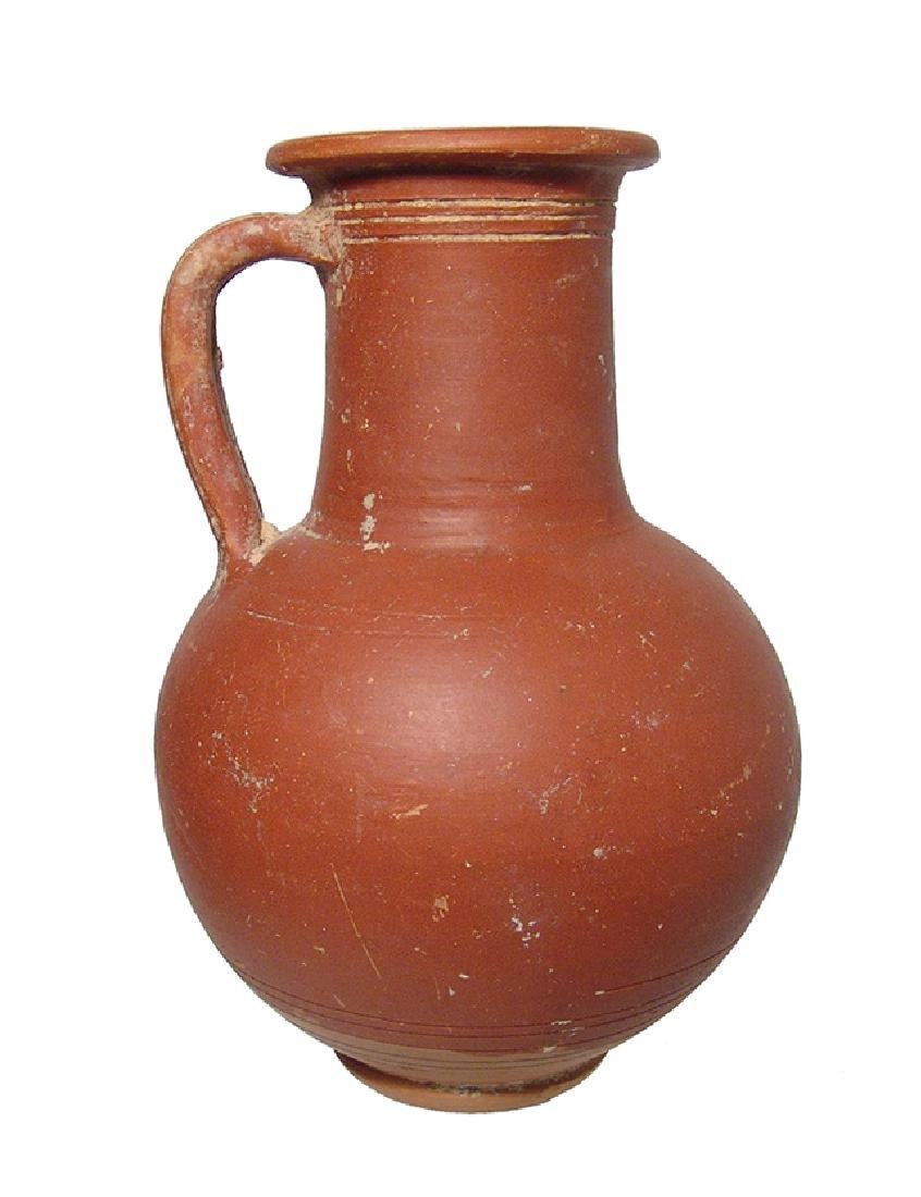 A large Roman red-ware olpe, North Africa
