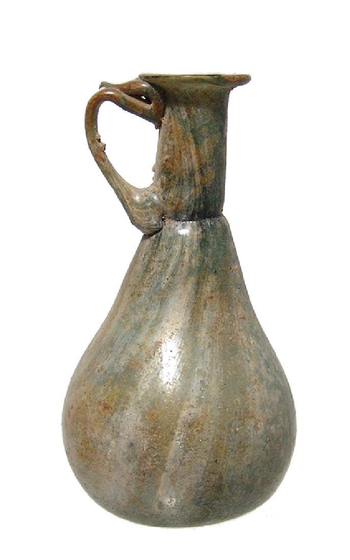 Roman green glass sprinkler vessel with white streaks