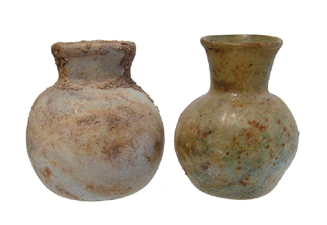 A pair of Late Roman / Byzantine glass bottles