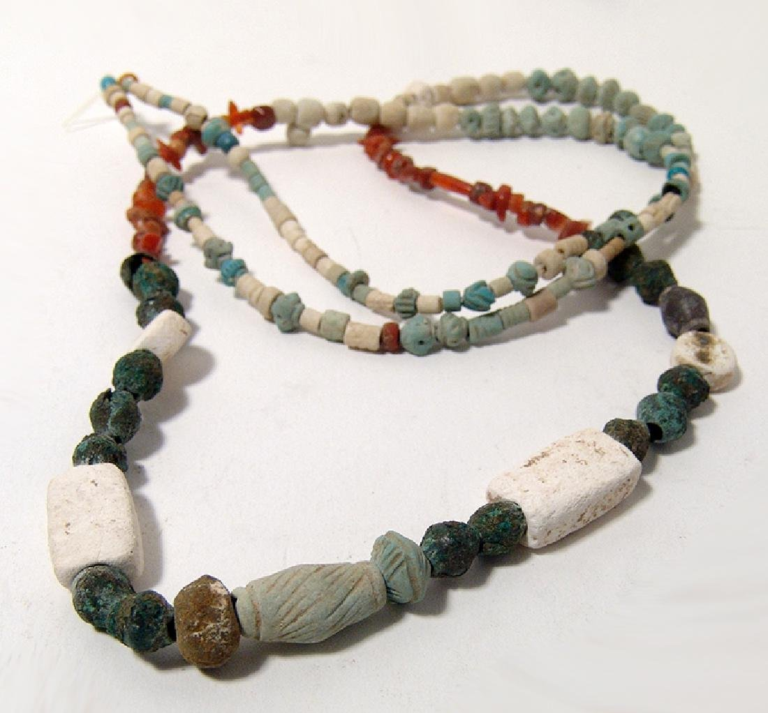 Strand of Persian faience, bronze and carnelian beads