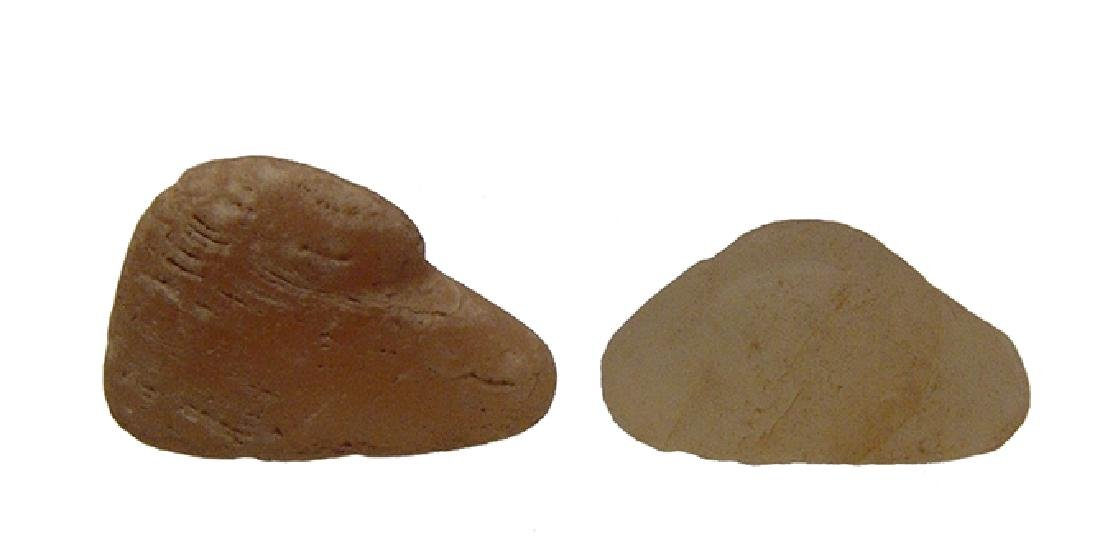 A pair of Mesopotamian calcite duck weights
