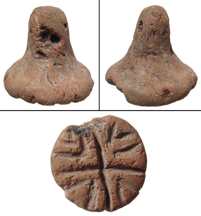 Circular terracotta Mesopotamian circular stamp seal