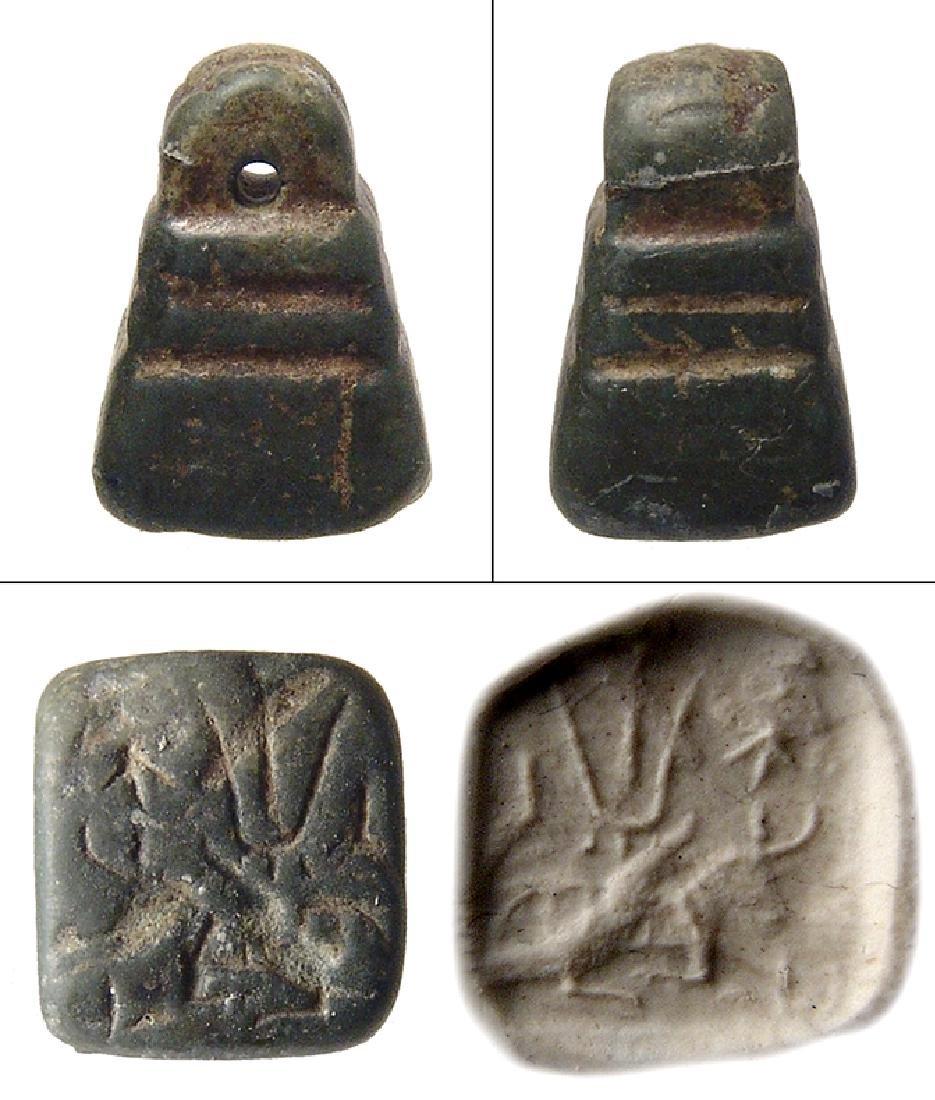 A green steatite pyramidal stamp seal, Anatolia