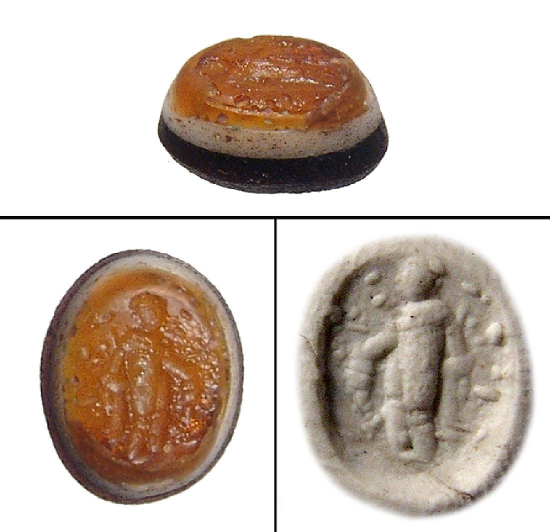 A Roman glass ring stone depicting a togate man