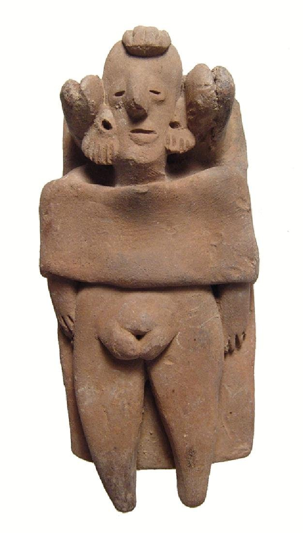 A Colima figure of a woman lying on a bed