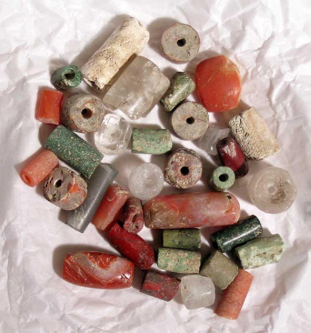 A collection of 35 Tairona stone beads from Colombia