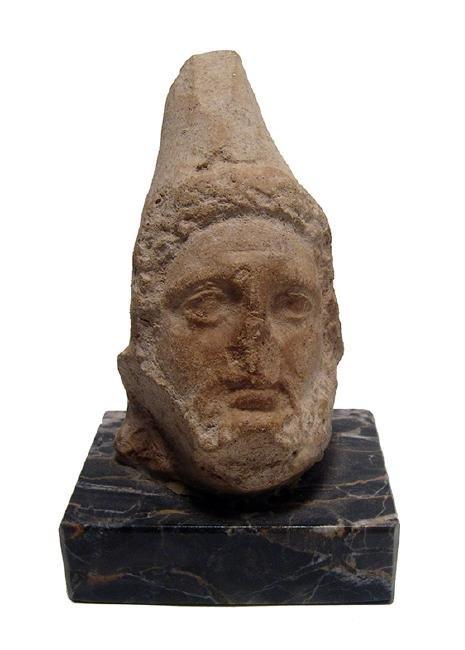 A Persian limestone head of a bearded male