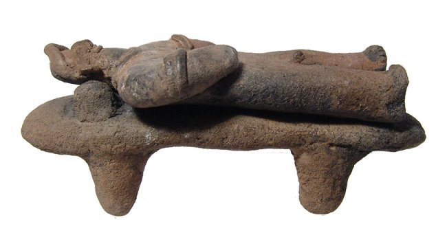 Ceramic Colima male figure lying on a bed, West Mexico