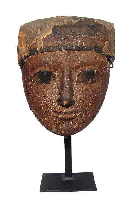 A beautiful Egyptian wood 'mummy' mask, Late Period