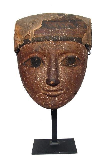A beautiful Egyptian wood 'mummy' mask, Late Period