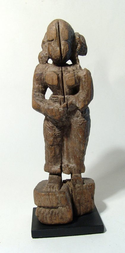 An Indian standing wood figure of a female deity