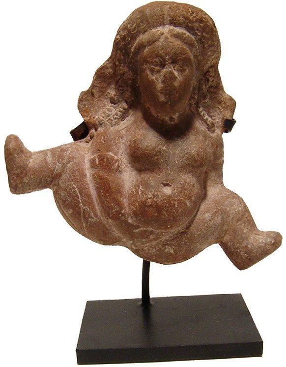 An Egyptian terracotta Baubo or fecundity figure