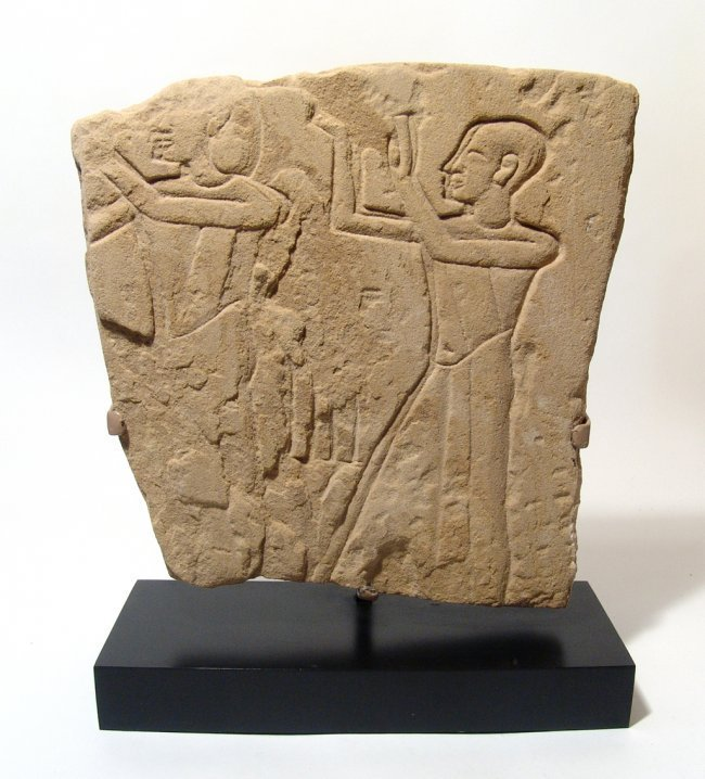 Egyptian sandstone relief depicting a scene of worship