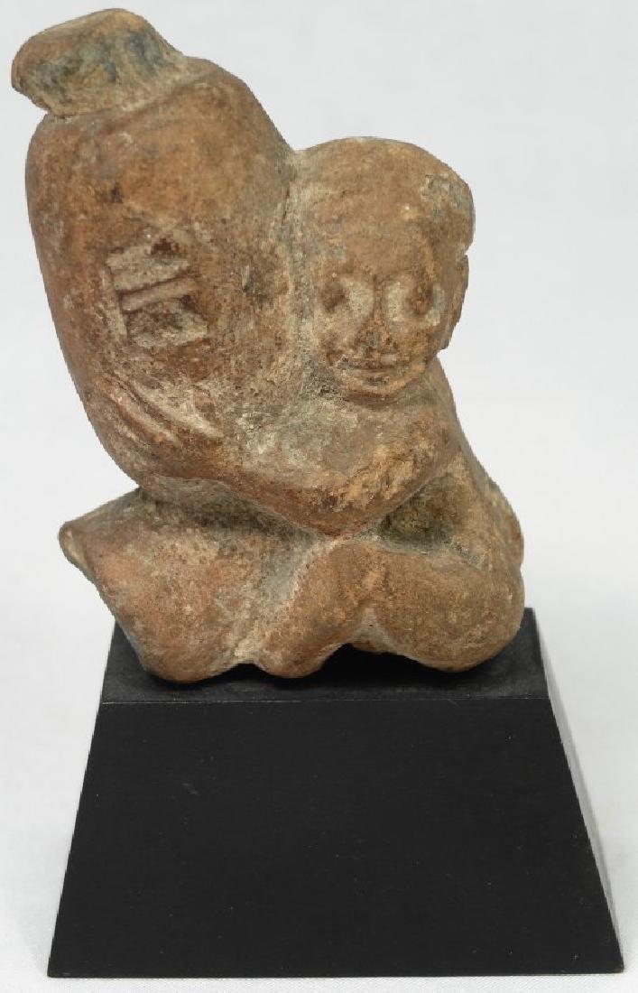 A fine Egyptian terracotta ithyphallic figure