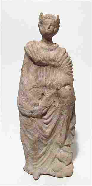 A late Hellenistic terracotta figure of a robed woman