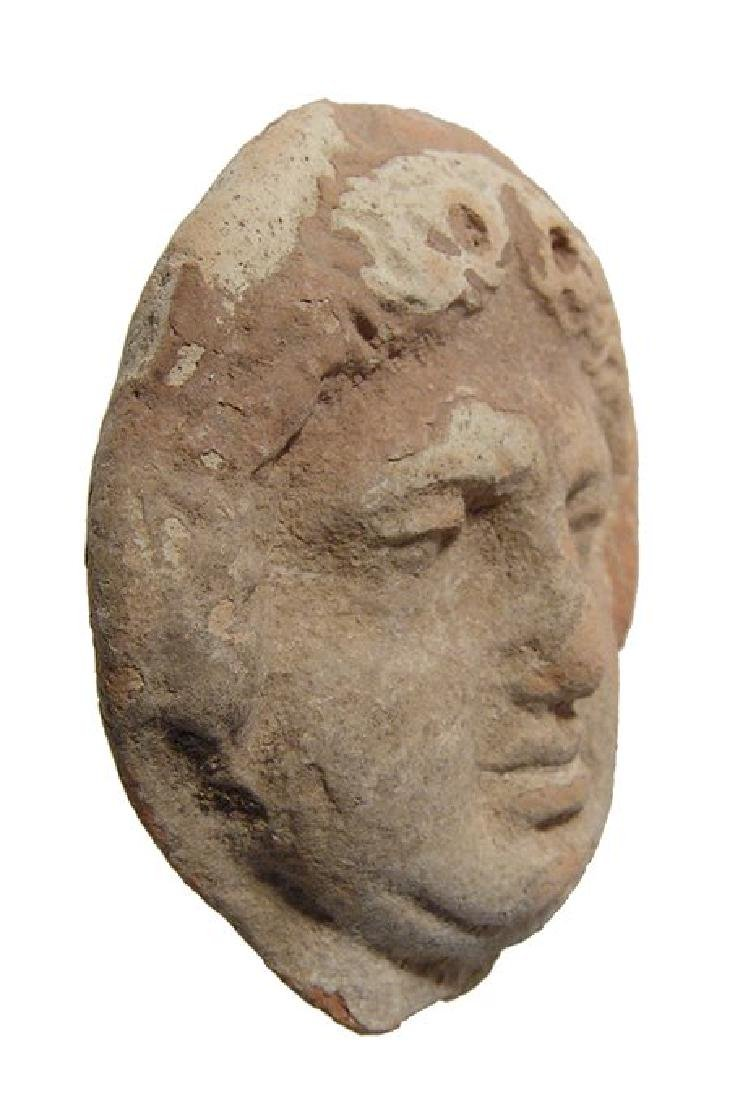 Greek terracotta roundel depicting the face of a Gorgon - 2