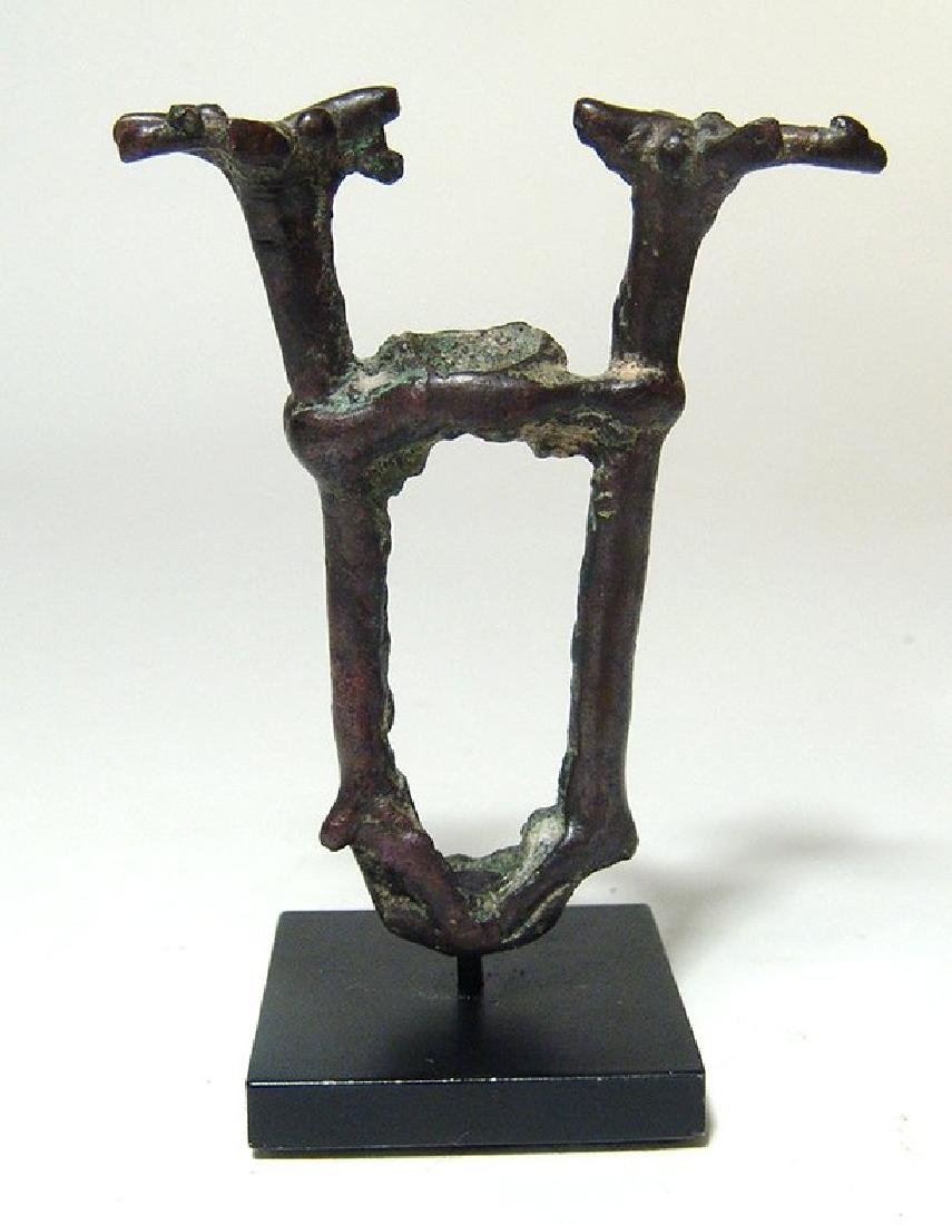 A Near Eastern bronze finial depicting two stags