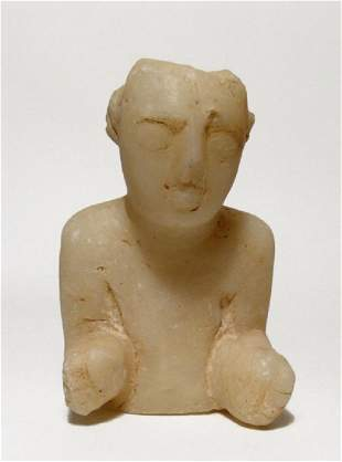 A Sabaean marble head and torso of a youth