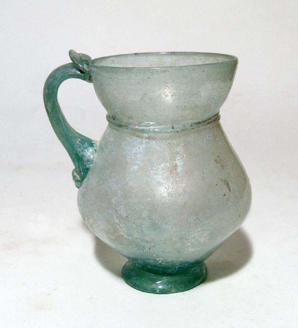 Beautifully formed Roman pale green glass handled cup