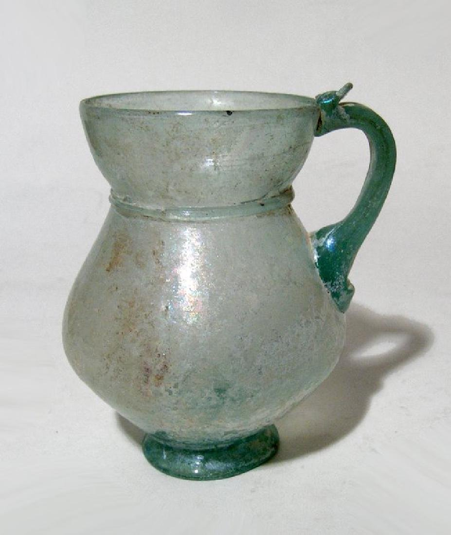 Beautifully formed Roman pale green glass handled cup - 2