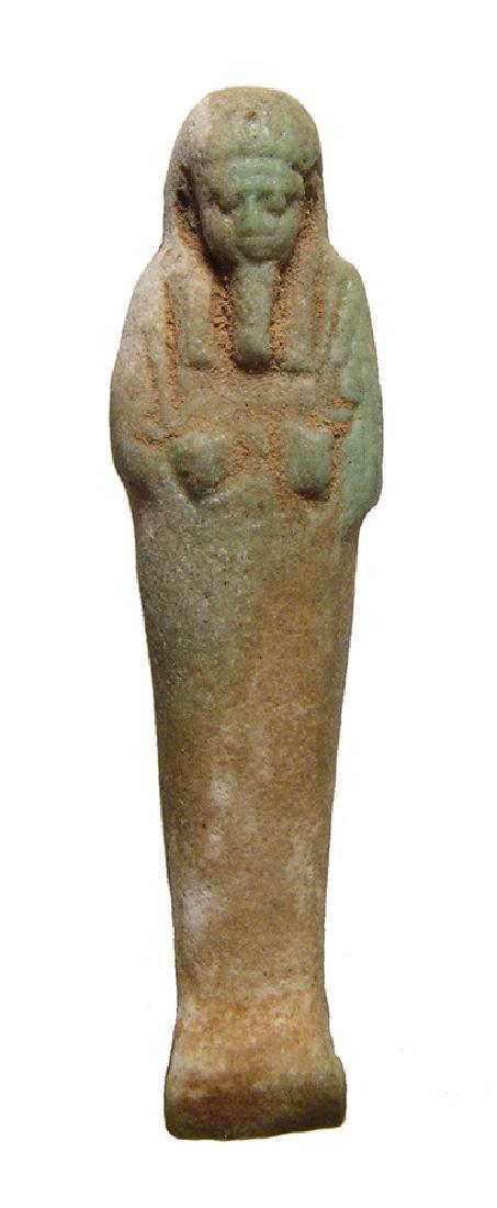An Egyptian light green faience ushabti
