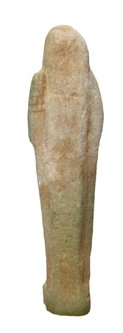 An Egyptian light green faience ushabti - 3