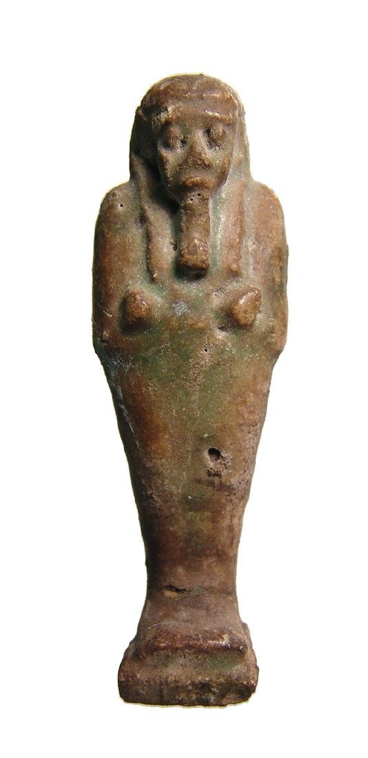 An Egyptian deep green faience ushabti, Late Period