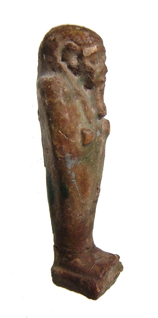 An Egyptian deep green faience ushabti, Late Period - 2
