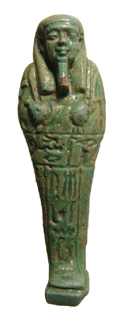 An Egyptian green faience ushabti, Late Period
