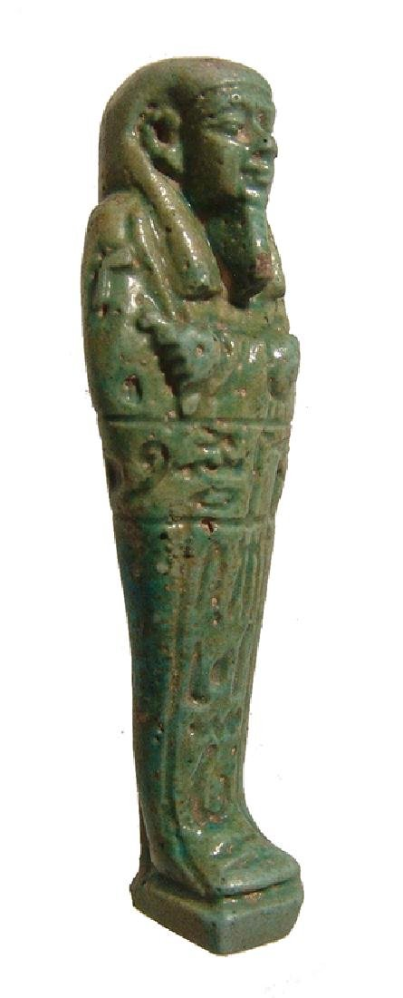 An Egyptian green faience ushabti, Late Period - 2