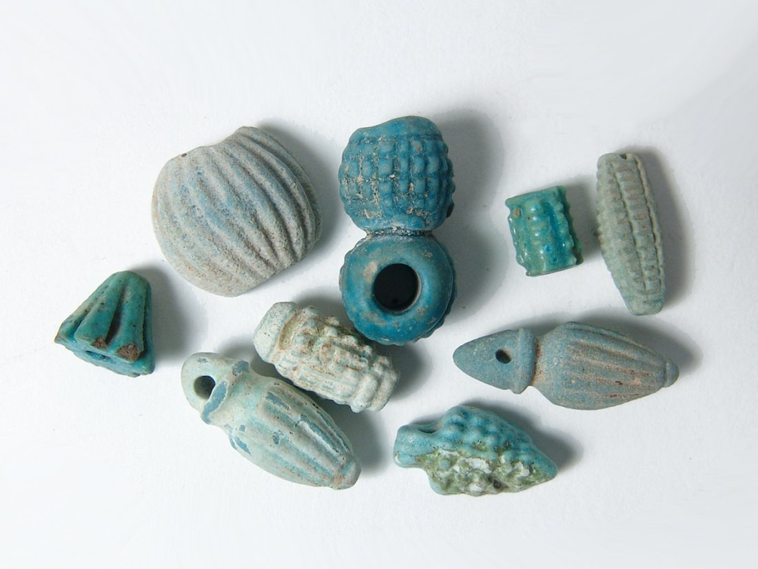 A group of 10 Egyptian faience beads and amulets