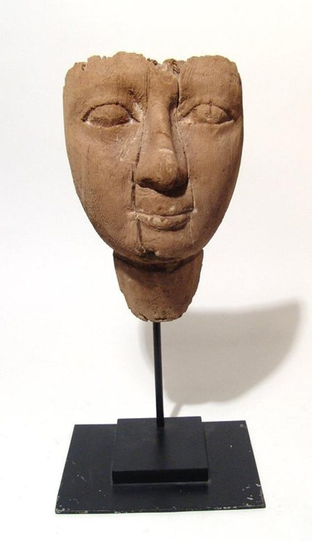 Egyptian wooden mummy mask with naturalistic detail