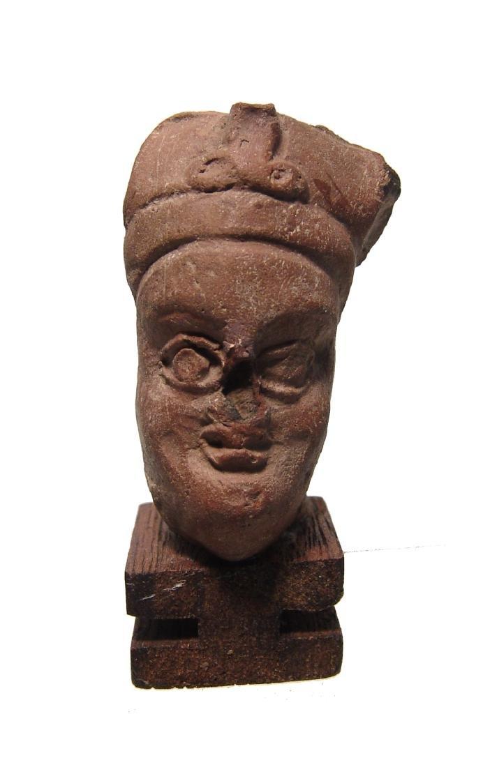 A Roman-Egyptian terracotta head of a pharaoh