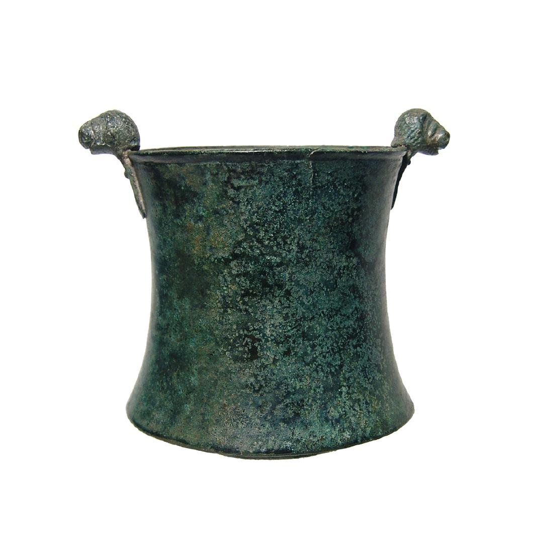 A choice Greek bronze cup with lion-headed knobs