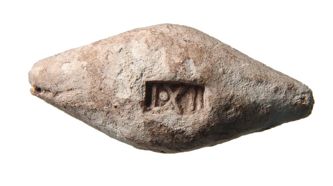 Roman lead sling bullet marked Legion XII Fulminata