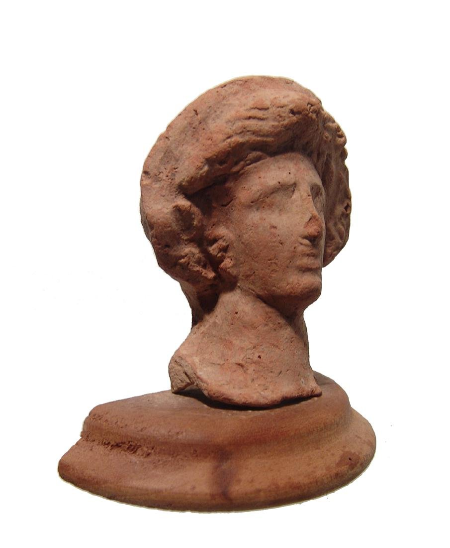 A Greek terracotta head of a woman - 2
