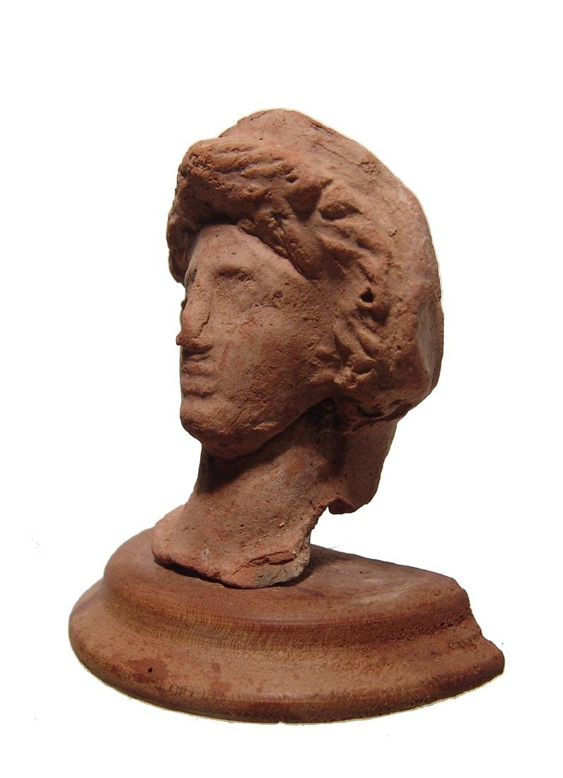 A Greek terracotta head of a woman - 3