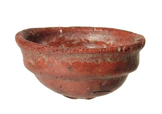 A neat Roman red mosaic glass votive bowl