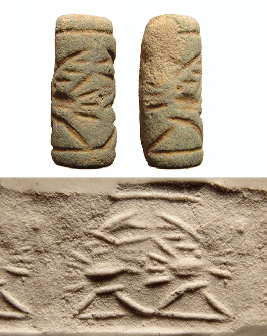 A nice Neo-Assyrian pale blue frit cylinder seal