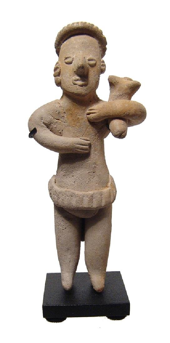 Charming Colima standing male figure holding puppy